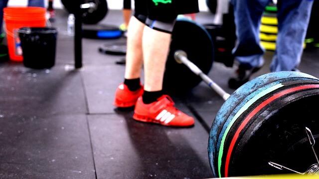 crossfit garage gym and barbells