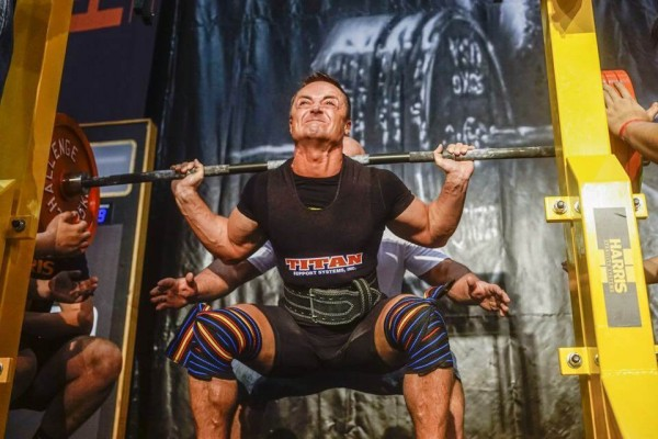Squat racking cave with bodybuilder