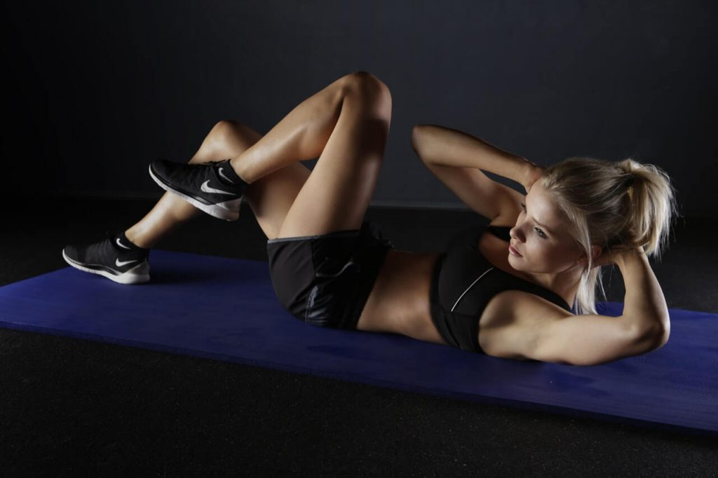 Women doing abs exercise