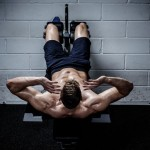 Muscular man doing exercises for abdominal in The Gym