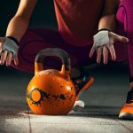 athlete woman is having training with kettlebell in garage gym