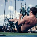 man training outdoor on TRX suspension trainer