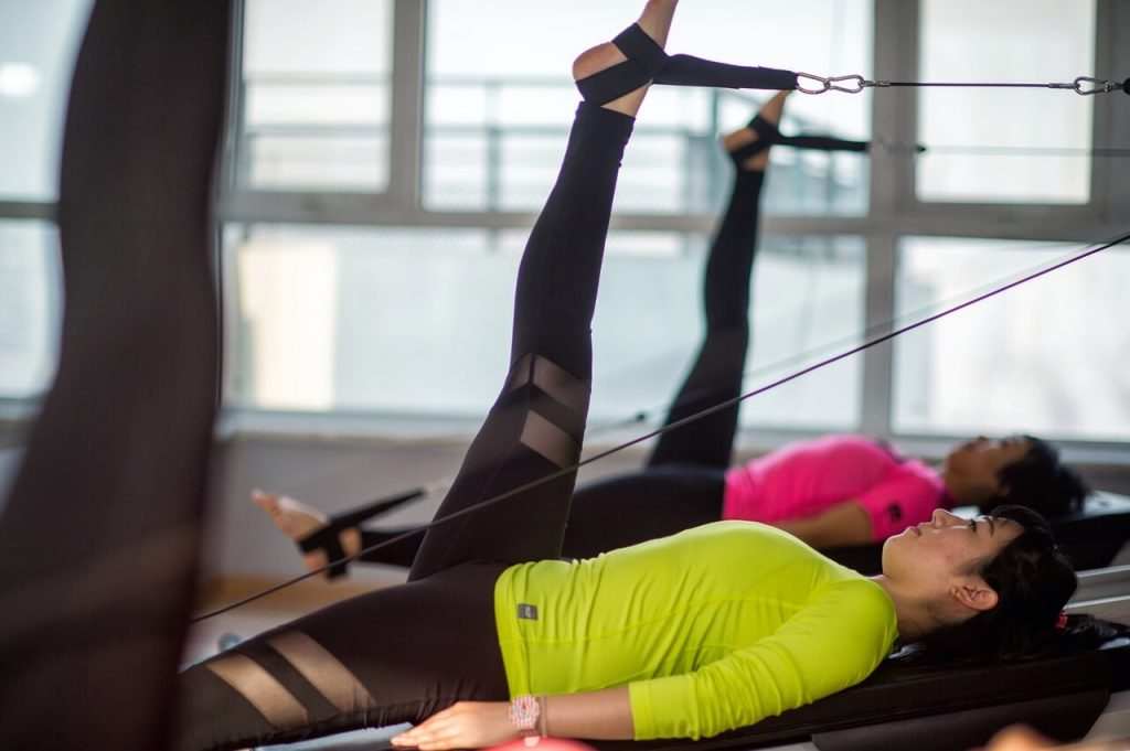 Pilates reformer workout at commercial gym