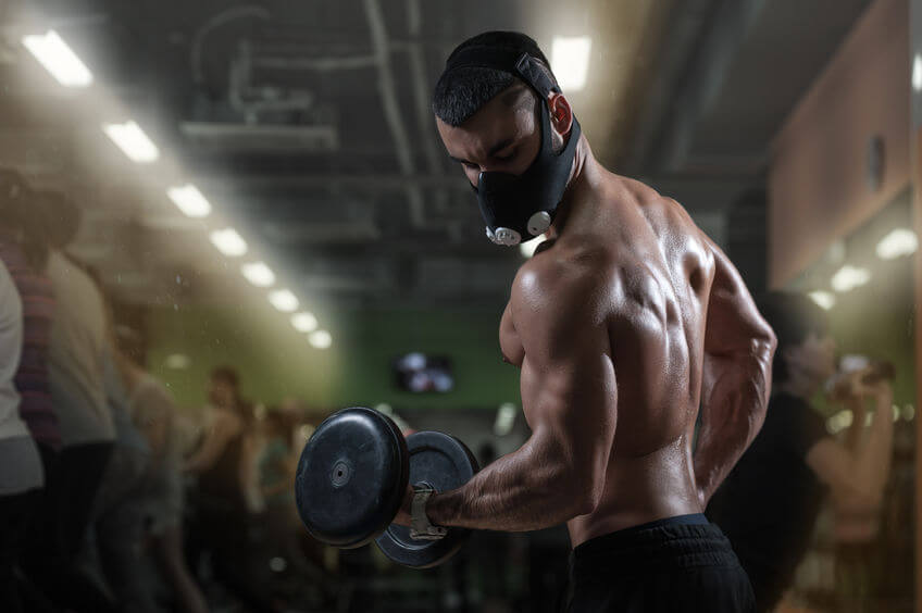 Workout at gym with elevation training mask