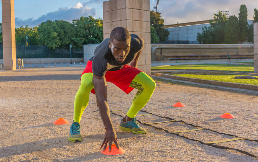man doing speed training with agility ladders