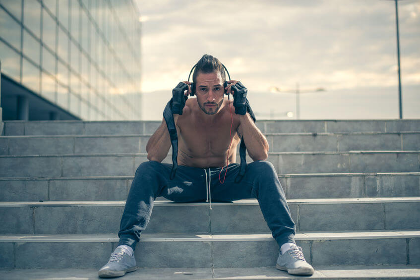 man athlete listening music with headphones