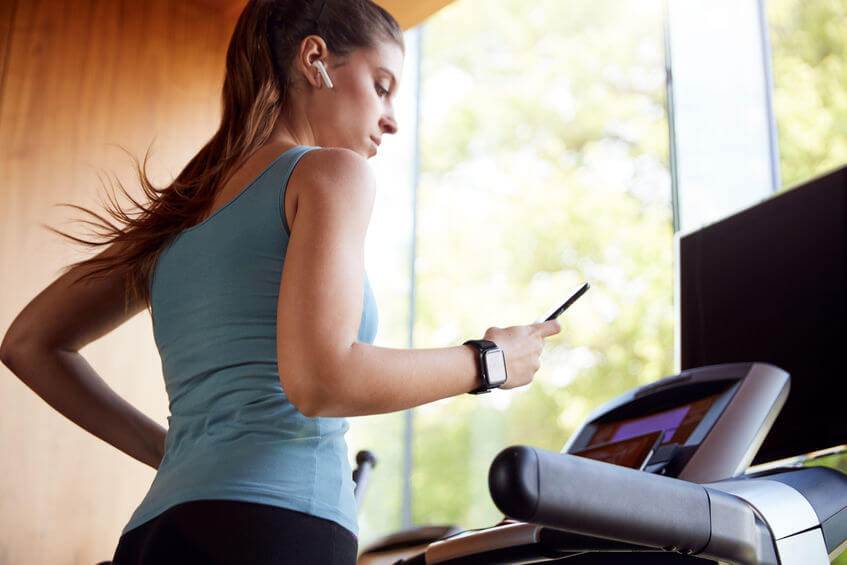 woman exercising on treadmill at home