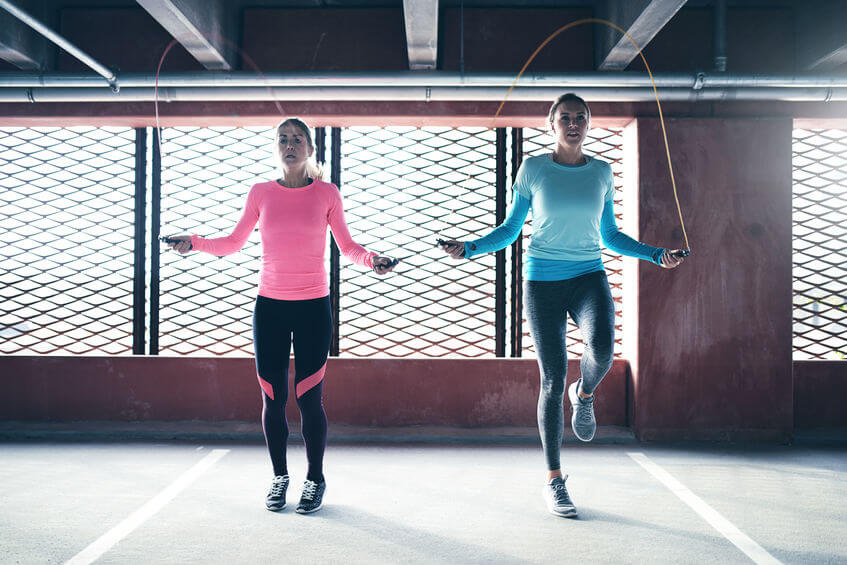 athletic girls doing jump rope exercise