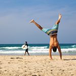 handstand man workout on beach vacation