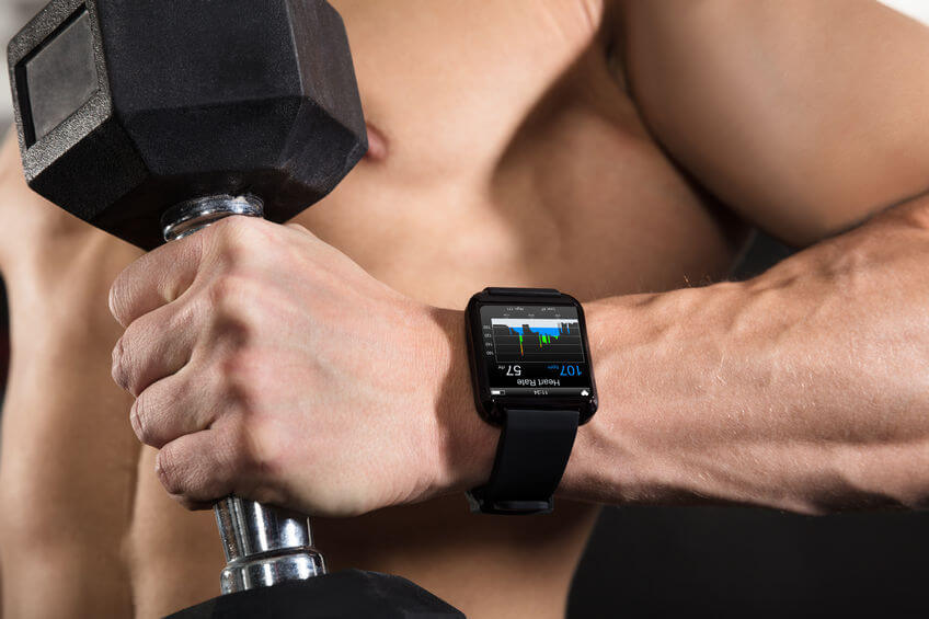 Athlete Man Wearing Smart Watch in Gym
