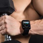 man wearing activity tracker in the CrossFit gym