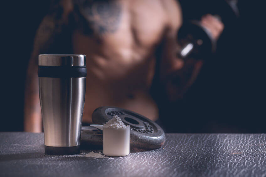 protein shaker, Whey protein powder and dumbbells