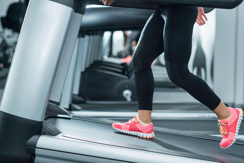 woman using incline treadmill in the gym