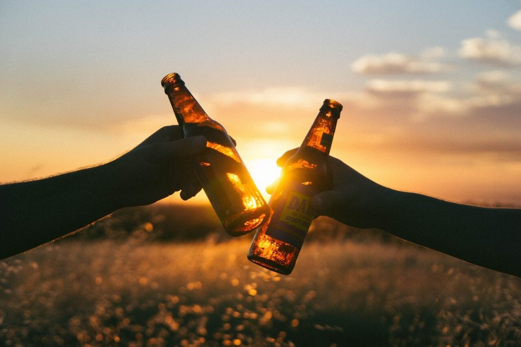 cheers - two beers and sunset