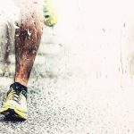 closeup of runners foot touching the asphalt rainy weather