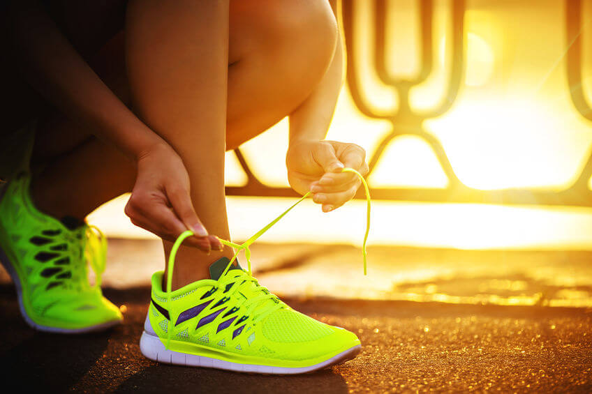 female runner with barefoot running shoes closeup