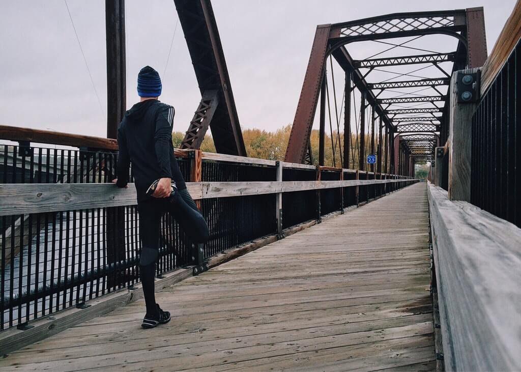runner stretching before morning run