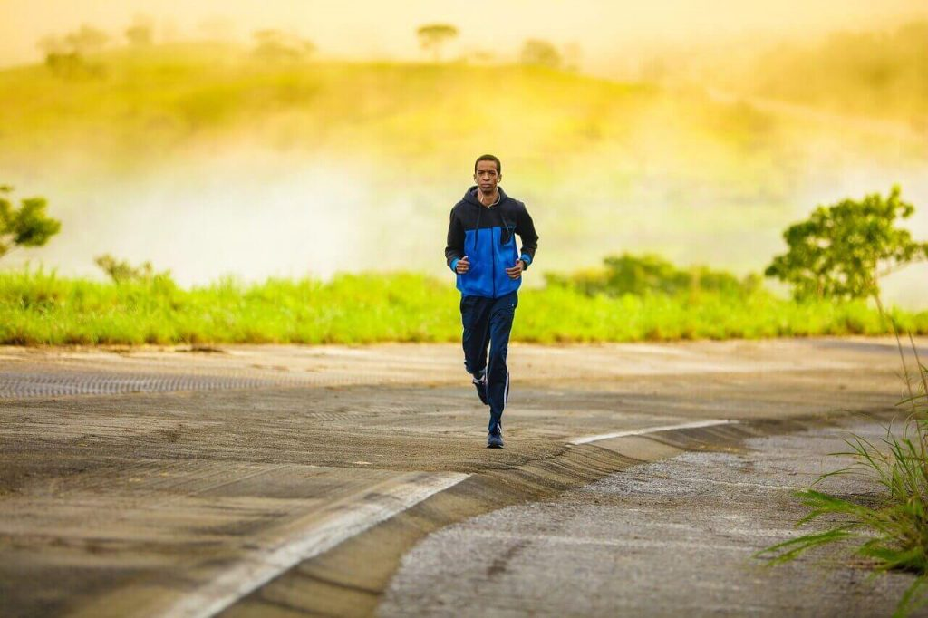 Man Running on the Road