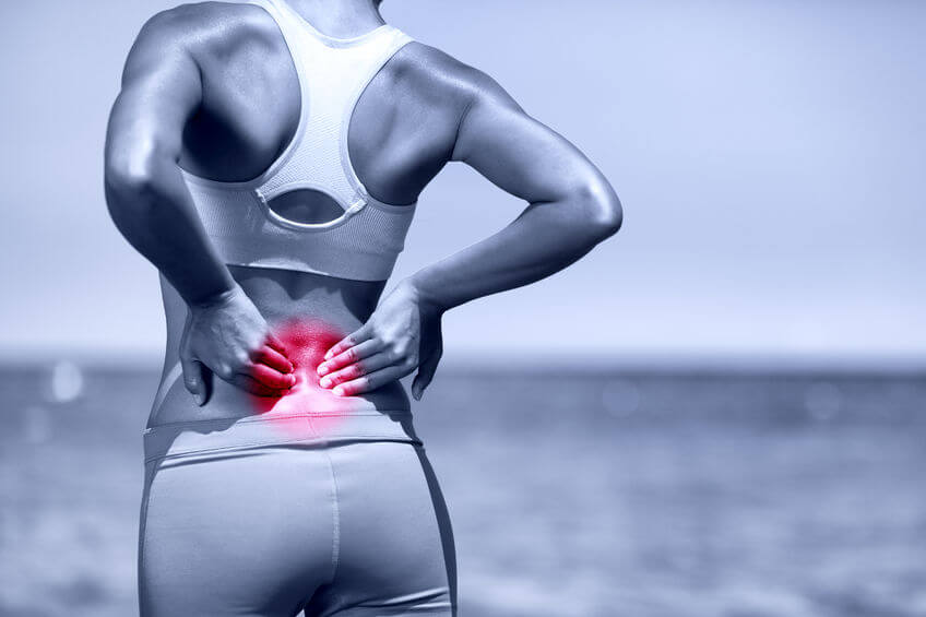 athletic running woman with back pain