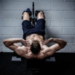 man doing ab workout exercise in the gym