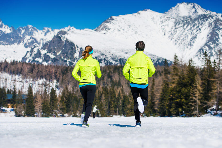 couple jogging outside in winter