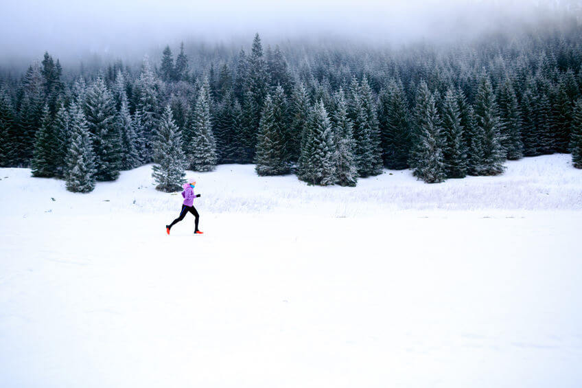 cross country running in mountains on snow