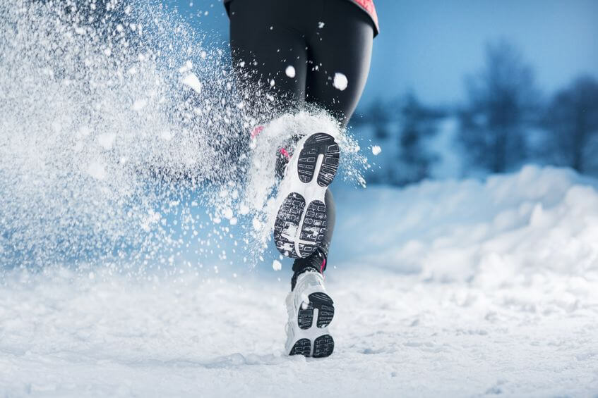 woman is running during winter