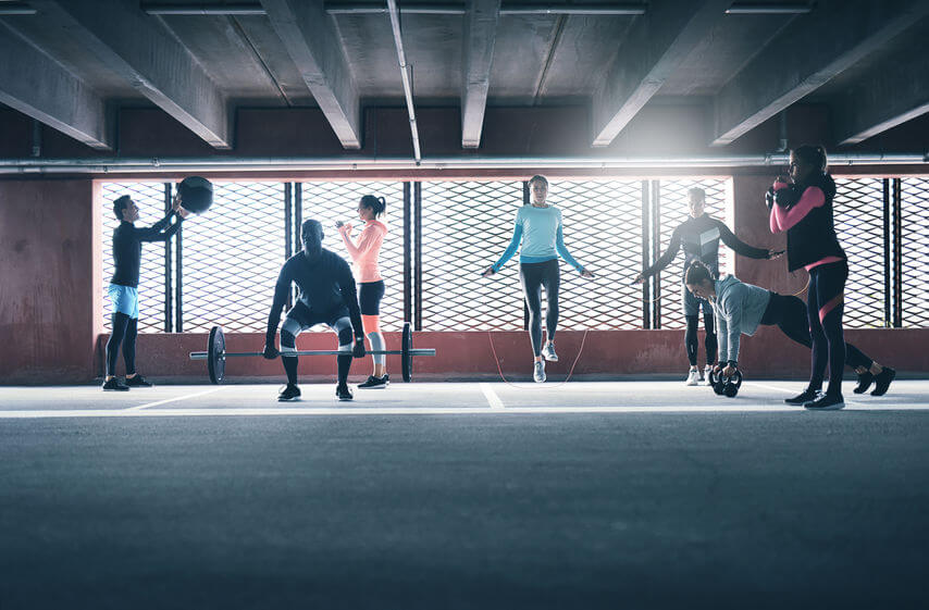 group of people exercising together in CrossFit gym