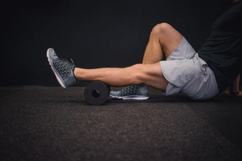 man using a foam roller