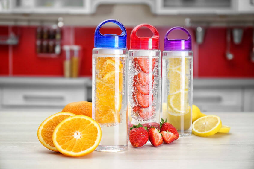 bottles with fruit-infused water