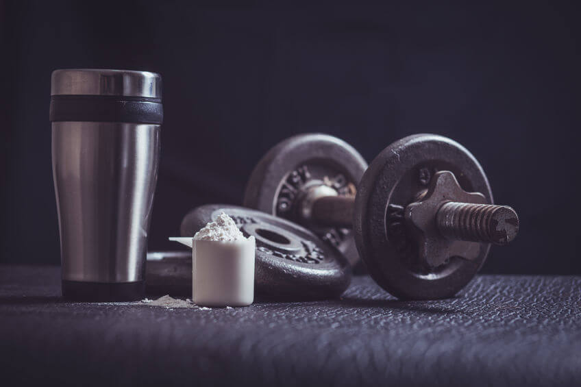 Whey protein shaker and dumbbells