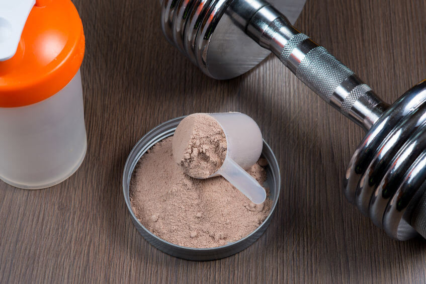 Whey protein with a metal dumbbell and shaker