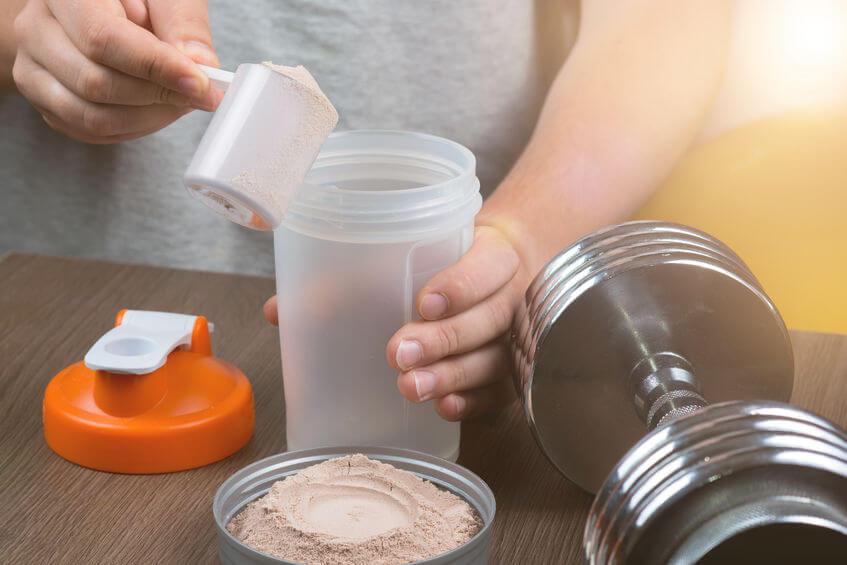 man preparing a protein shake
