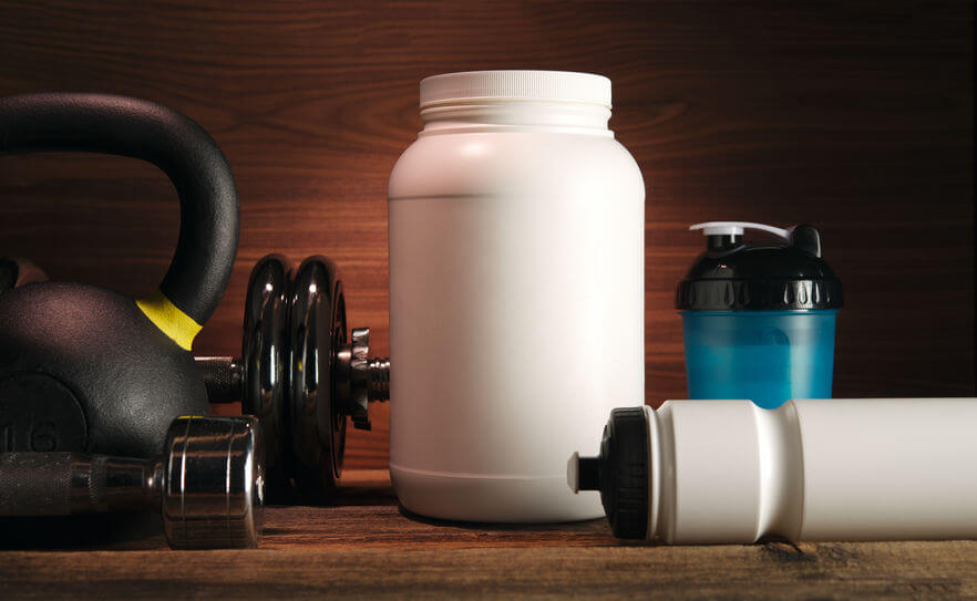 white jar with whey protein powder