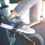 woman foot close up - using indoor exercise bike