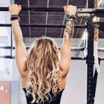 blonde girl doing pull ups