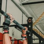 person doing pull up exercise in CrossFit gym