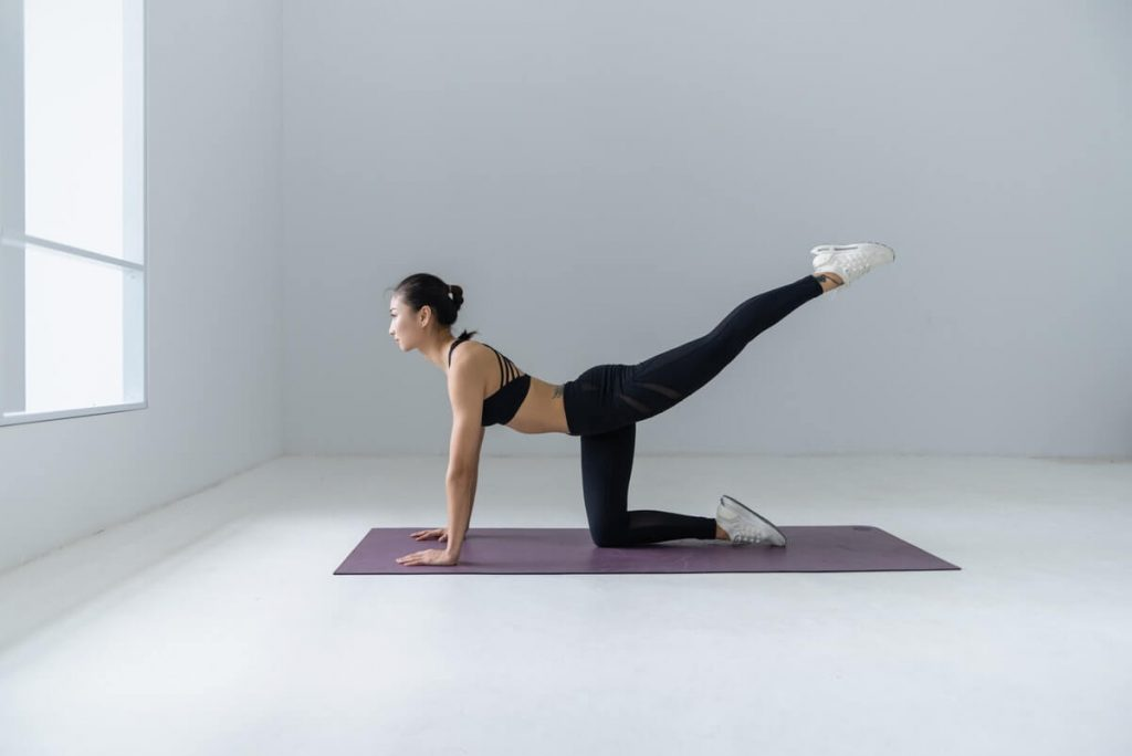 active woman doing yoga exercise