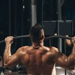 man doing lat pulldown exercise at the gym