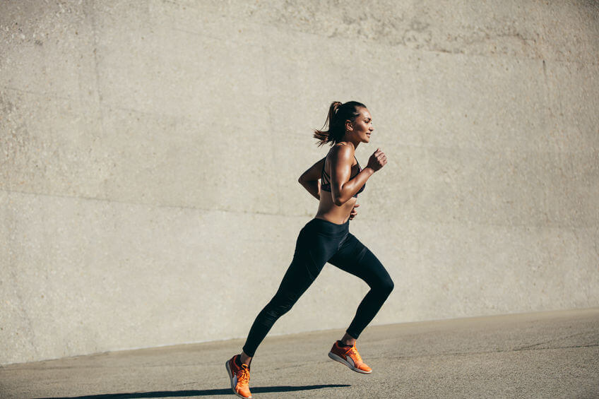 young woman running in morning outdoor