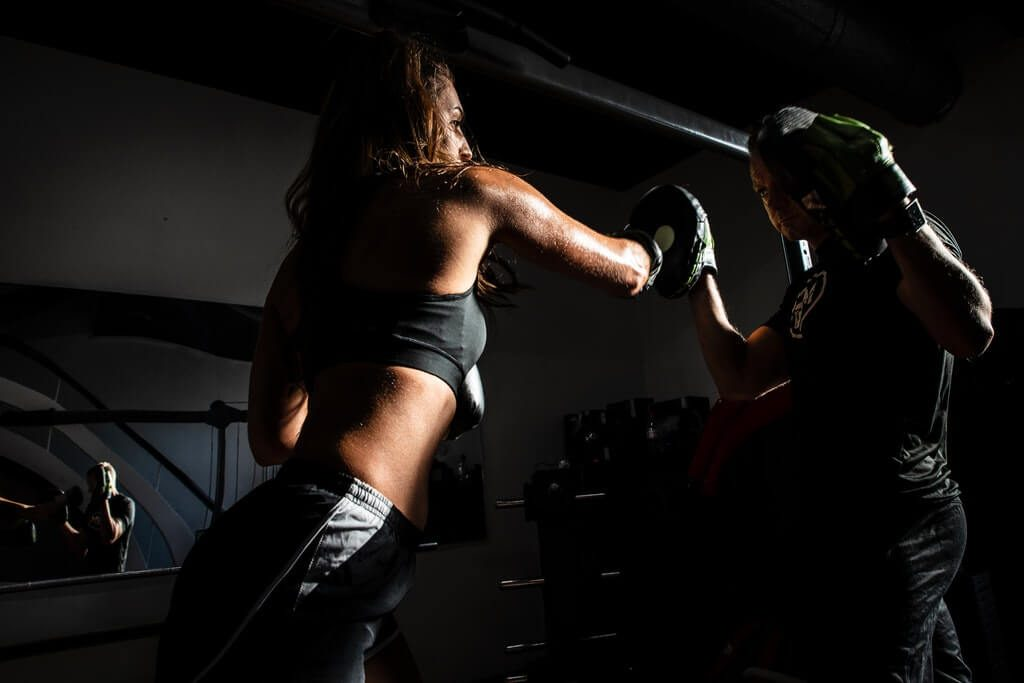woman boxing inside the gym