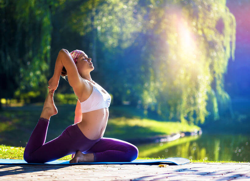 young woman doing yoga exercise in morning