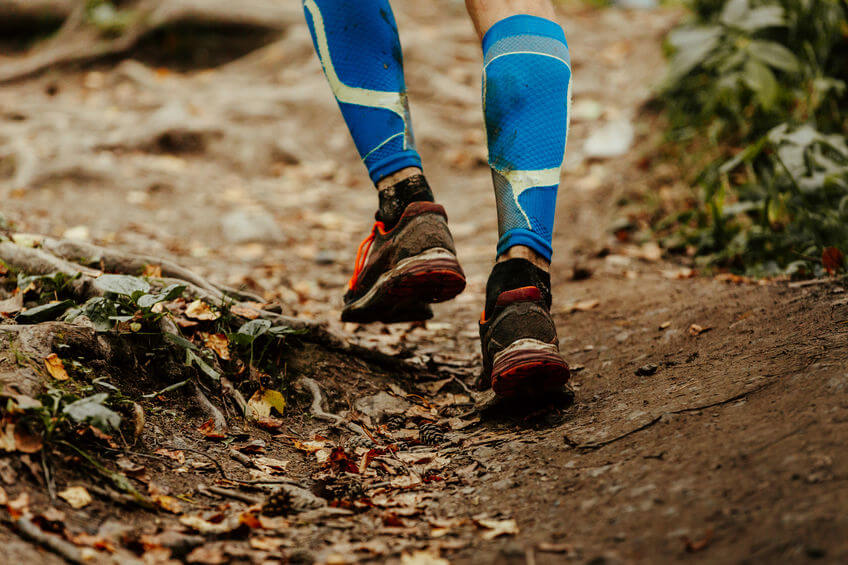 trail runner wearing compression calf sleeves