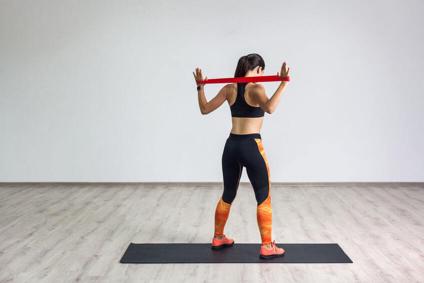 woman workout with resistance bands