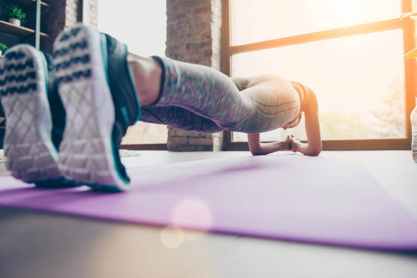close up photo of woman holding plank position