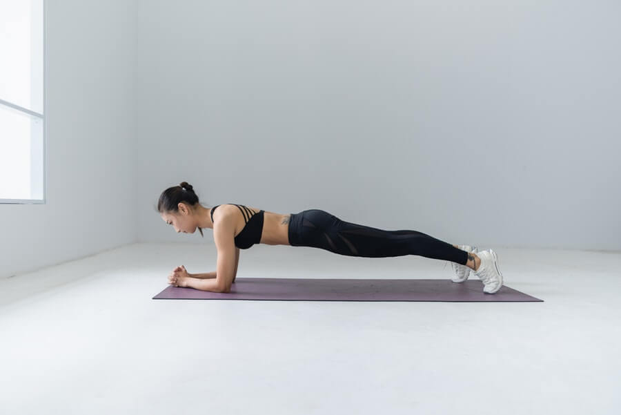 woman doing plank exercise at home