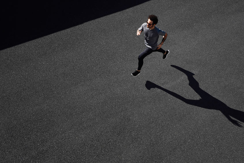 top view of man running on road
