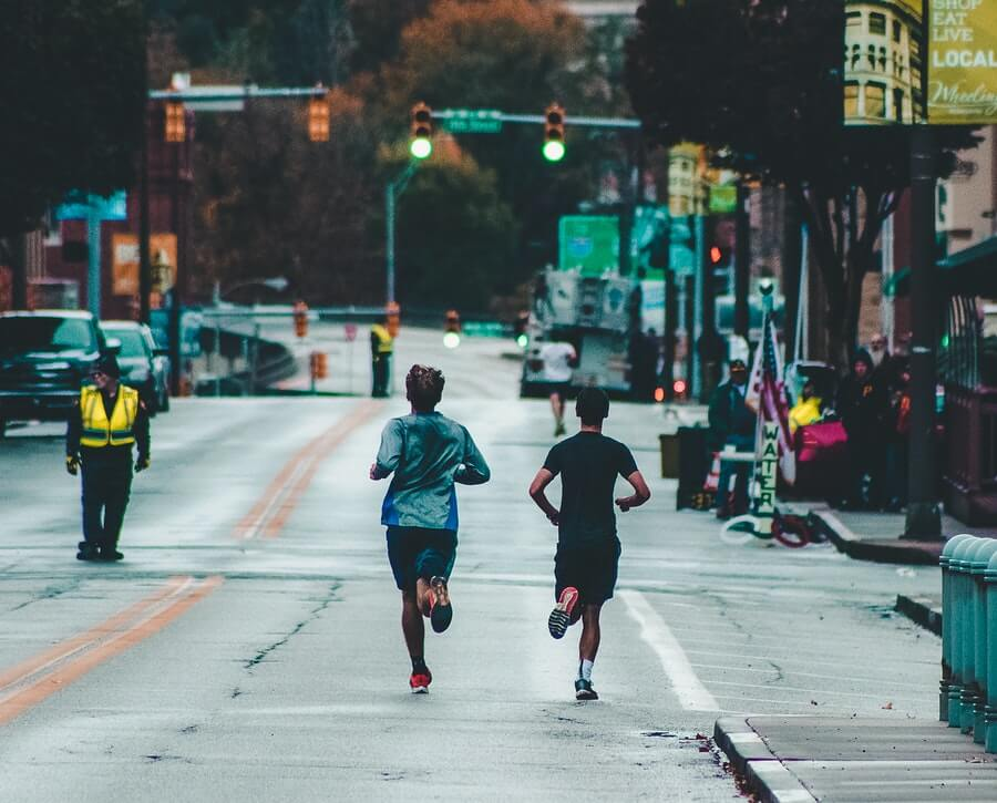 two men running marathon