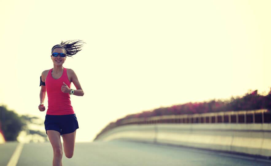 woman runner running on city bridge